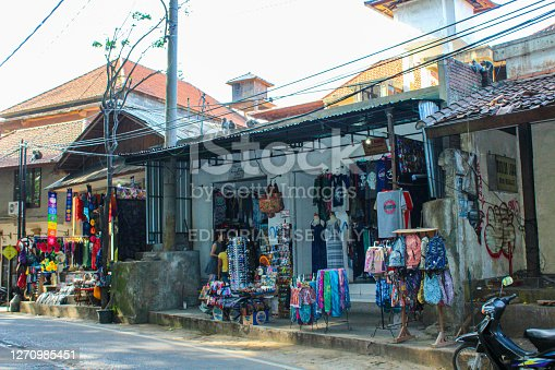 In September 2015, tourists were buying souvenirs in gift shop in front of Monkey forest, Ubud, Indonesia