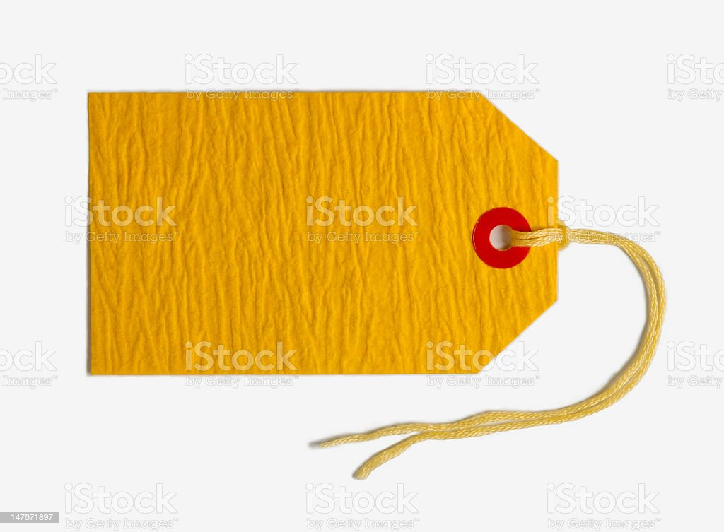 Gift tag made of chrome yellow handmade paper royalty-free stock photo