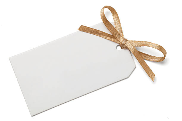 Gift Tag with Bow Blank gift tag and gold ribbon bow isolated on white with clipping path. gift card stock pictures, royalty-free photos & images