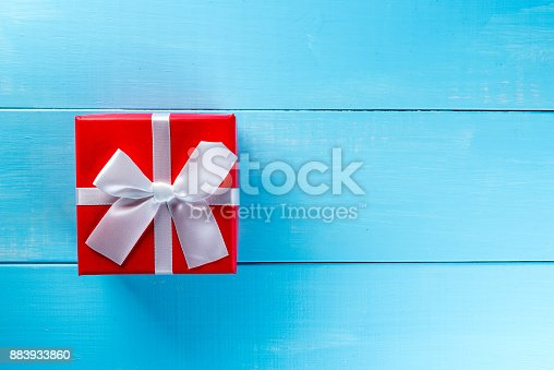 istock Gift trends. Thinking about new year, Christmas and valentine day gifts and online shopping. Red box present with bow 883933860