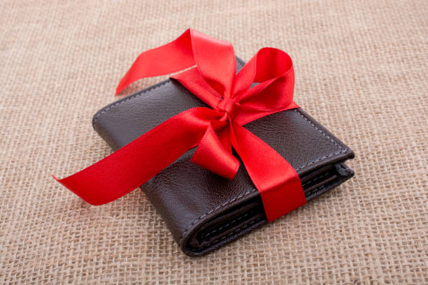 Gift wallet wrapped with red ribbon stock photo