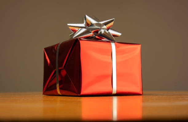A gift wrapped in red gift paper for a special occasion stock photo