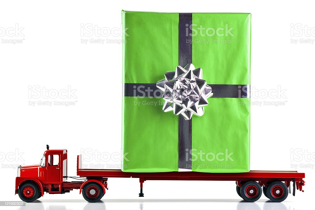 Gift Wrapped Present Being Delivered By Truck Stock Photo
