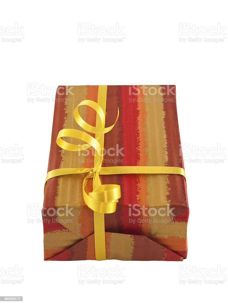Gift wrapped present with a yellow ribbon, isolated on white royalty-free stock photo