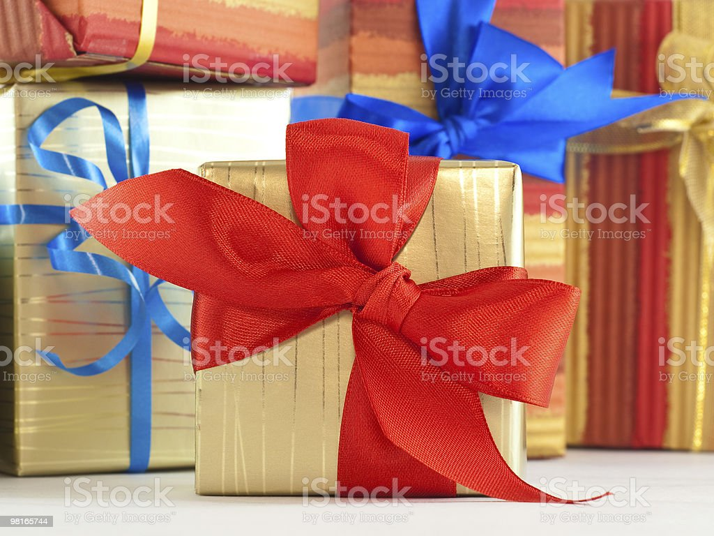 Gift wrapped present with red satin bow royalty-free stock photo
