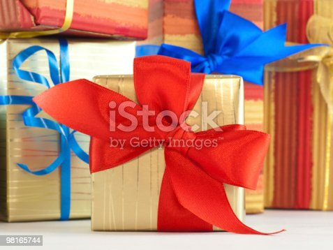 Gift Wrapped Present With Red Satin Bow Stock Photo & More Pictures of Backgrounds