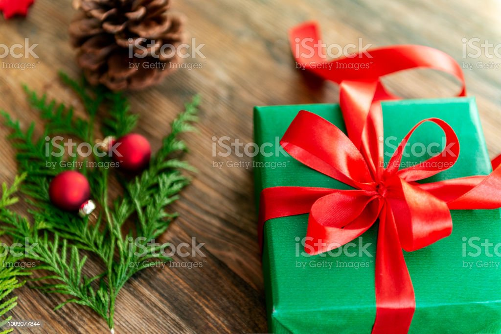 Christmas Gift Wrapping Station.Diy Gift Wrapping Beautiful Green Christmas Gift With Red Bow On Rustic Wooden Table Top View Of Christmas Wrapping Station Stock Photo Download