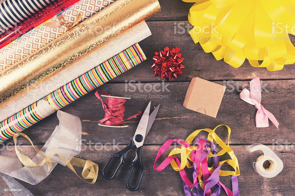 gift wrapping rolls and accessories on the table stock photo