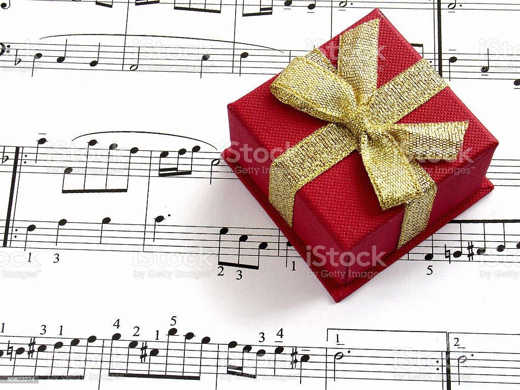 giftbox on music sheet royalty-free stock photo