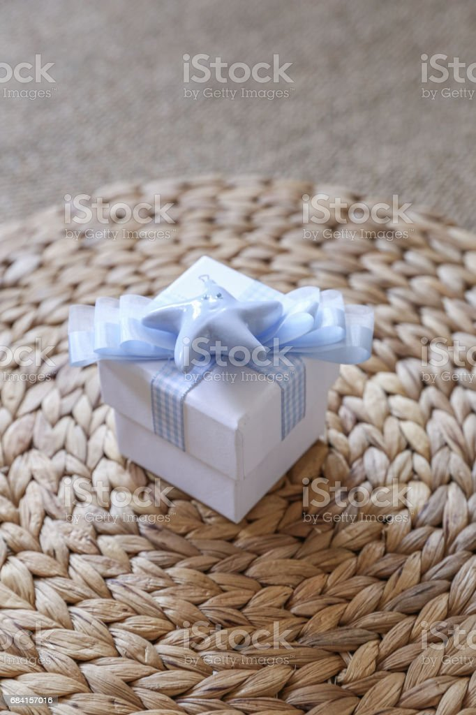 A Giftbox on the floor royaltyfri bildbanksbilder