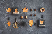 Gifts, autumn golden leaves, accessories. Flat lay, top view