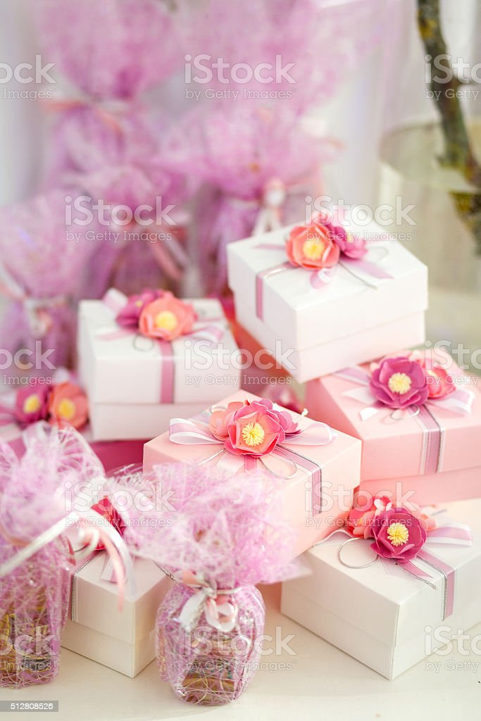 Gifts boxes for guests in rose color with ribbon stock photo