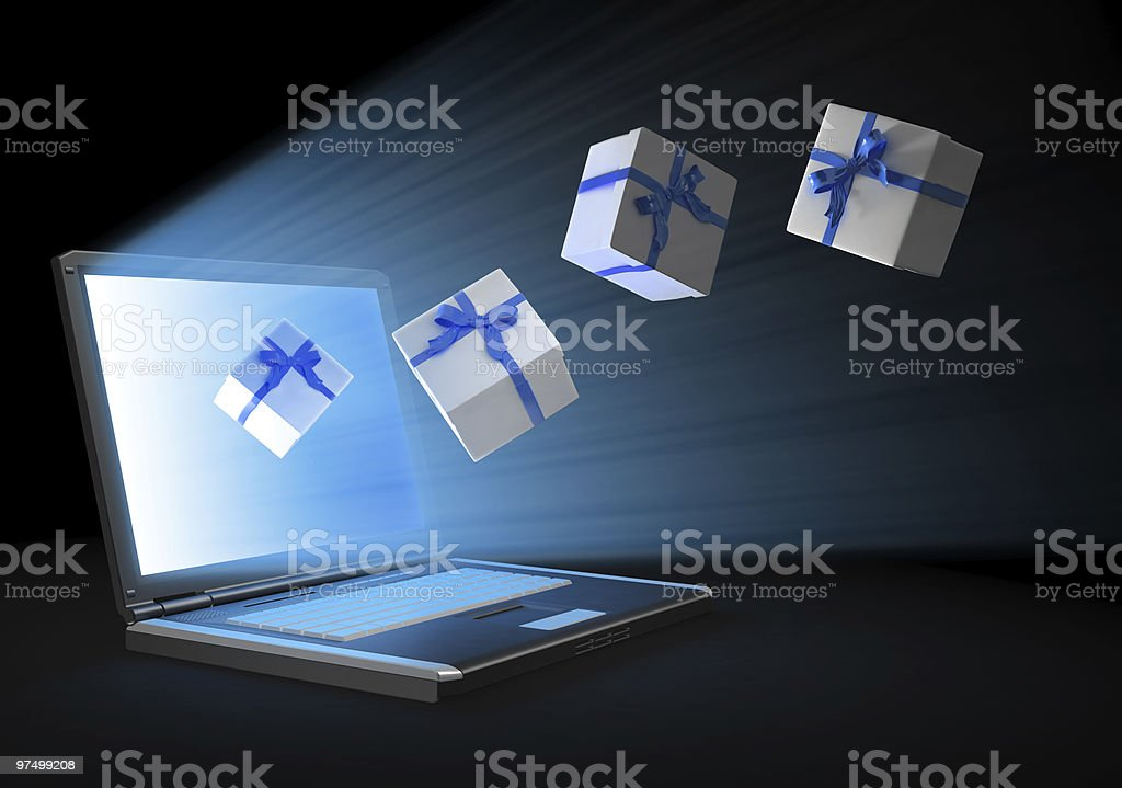Gifts flying out of a computer screen royalty-free stock photo