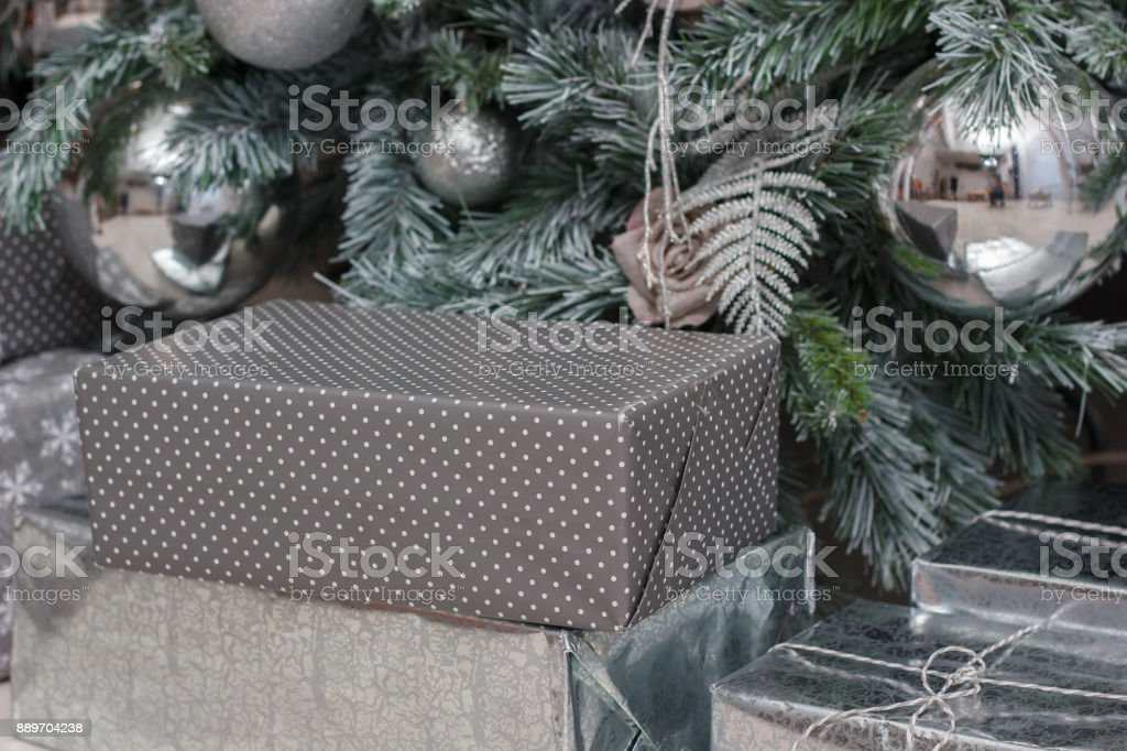 Gifts in a box under the christmas tree. stock photo