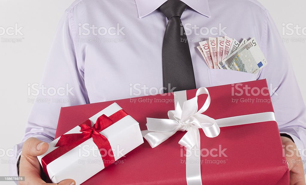 Gifts In Arms Beside Money royalty-free stock photo