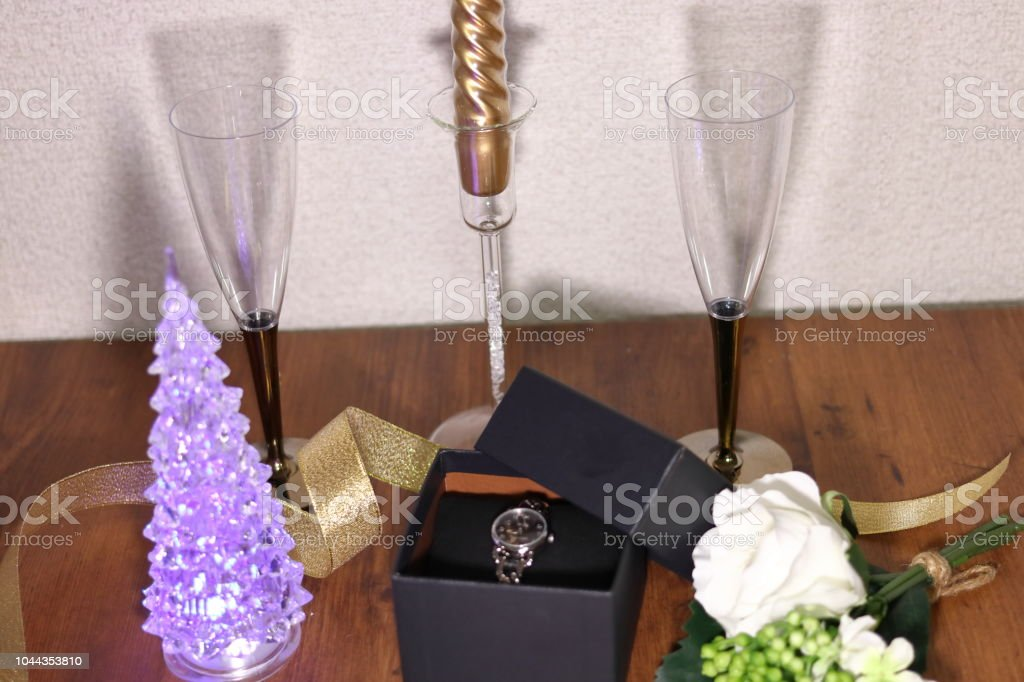 Gifts Of Watch In Box And Champagne Glass And Christmas Tree