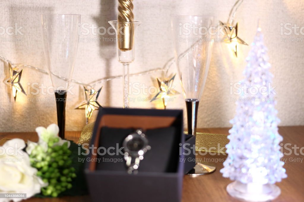 Gifts Of Watch In Box And Champagne Glass And Christmas Tree On The