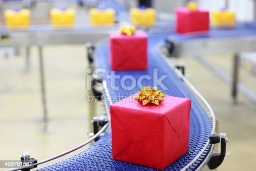 istock Gifts on conveyor belt in Christmas presents factory 453751567