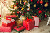 istock Gifts under a Christmas spruce 623377518