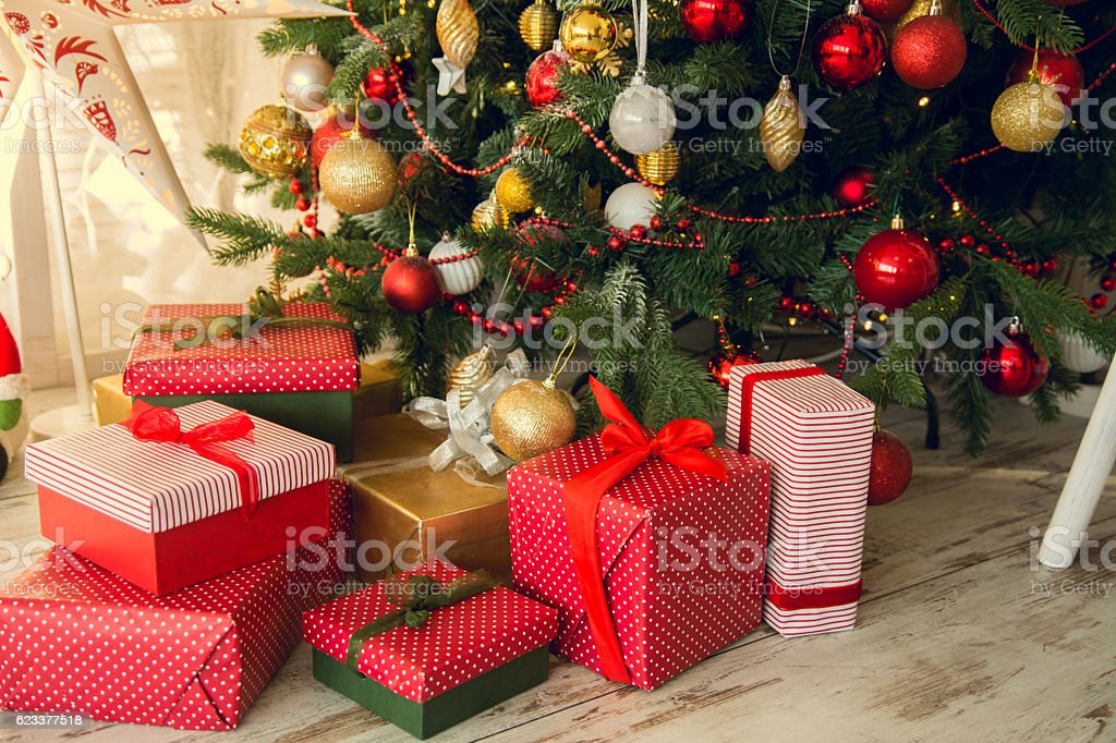 Gifts under a Christmas spruce stock photo