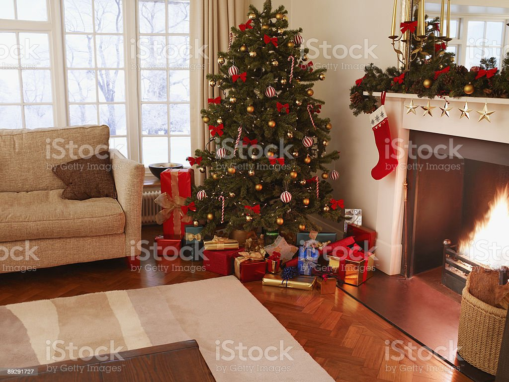 Gifts under Christmas tree in living room stock photo