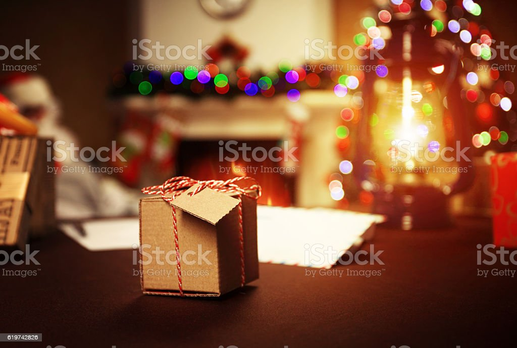 Gifts under Christmas tree lights background stock photo