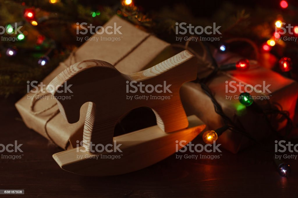 Gifts under the Christmas tree lights background stock photo