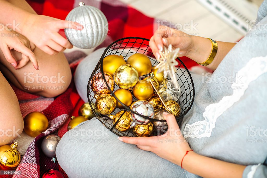 Gifts under the Christmas tree lights stock photo