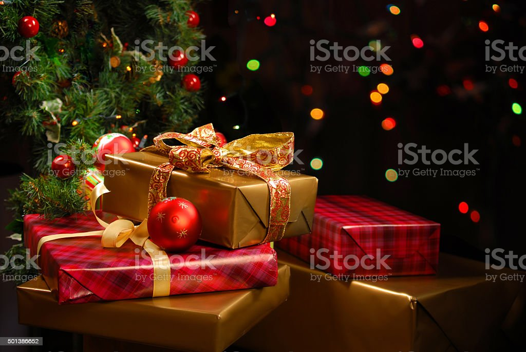 Gifts under the Christmas tree stock photo
