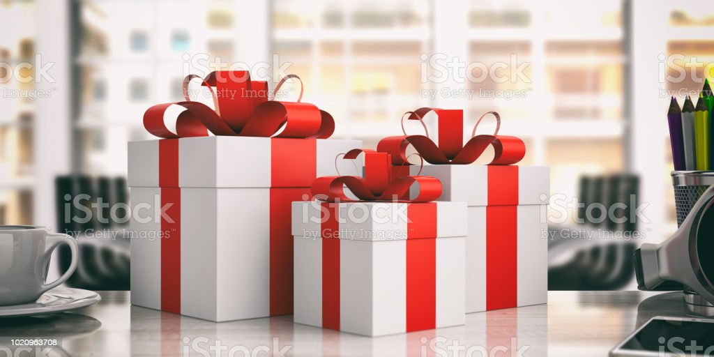 White gift boxes with red ribbons on an office desk. 3d illustration