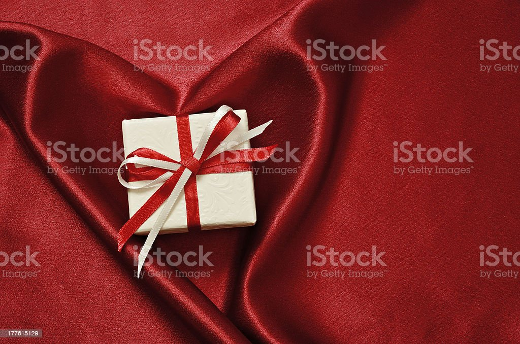Gify box on red satin royalty-free stock photo