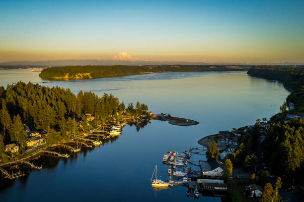 Gig Harbor Washington Aerial Golden Hour Aerial view of Gig Harbor entrance around sunset plus Mt Rainier gig harbor stock pictures, royalty-free photos & images
