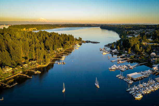 Gig Harbor Washington Aerial Landscape Golden Hour Aerial view of Gig Harbor entrance around sunset plus Mt Rainier puget sound stock pictures, royalty-free photos & images