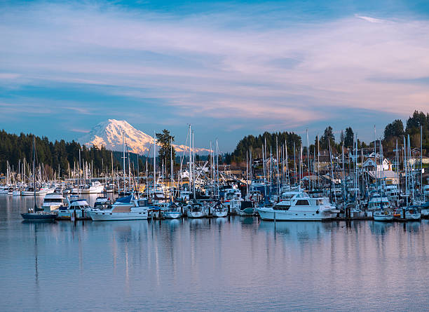 Gig Harbor Waterfront. Gig Harbor, WA USA - January, 20 2014. Gig Harbor with its beautiful views on Puget Sound and Mt Rainier is a popular tourism destination. gig harbor stock pictures, royalty-free photos & images