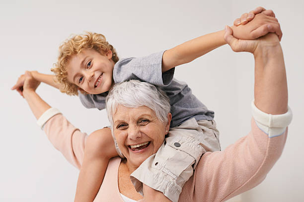 giggles with my grandson - arms outstretched stock photos and pictures