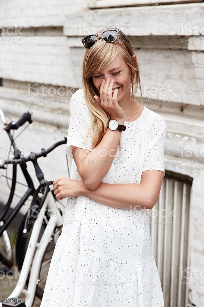 Giggling girl in white stock photo