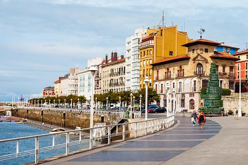 GIJON, SPAIN - SEPTEMBER 25, 2017: Gijon embankment promenade. Gijon is the largest city of Asturias in Spain.