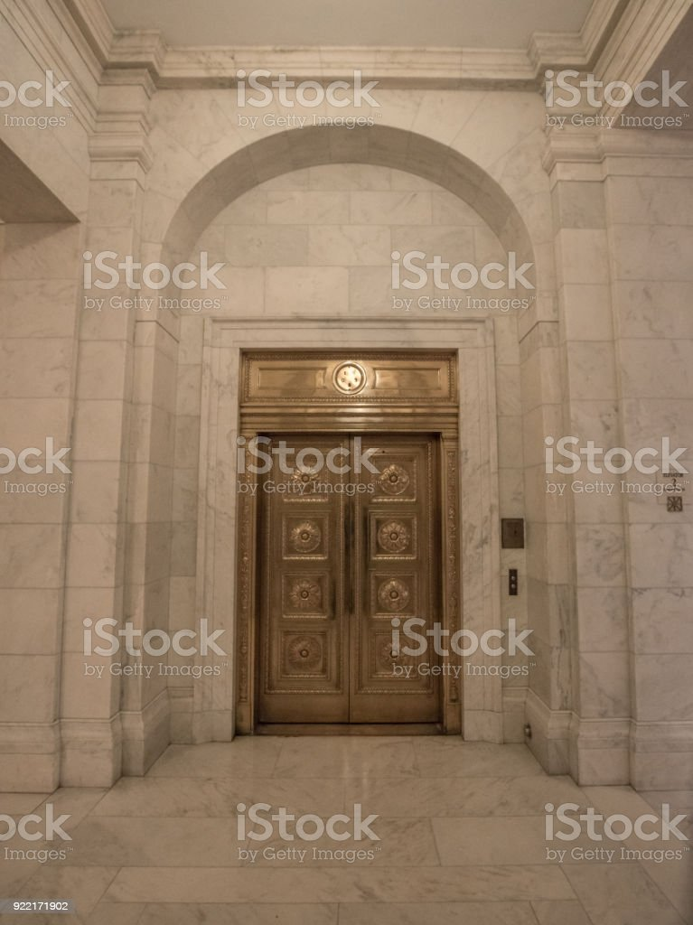 Gilded Elevator Doors in the Supreme Court of the United States in Washington, DC stock photo