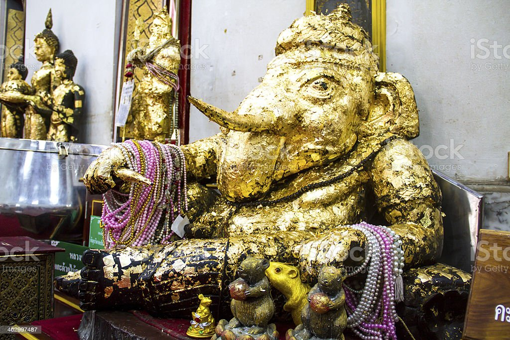 Gilded ganesh statue in thai temple royalty-free stock photo