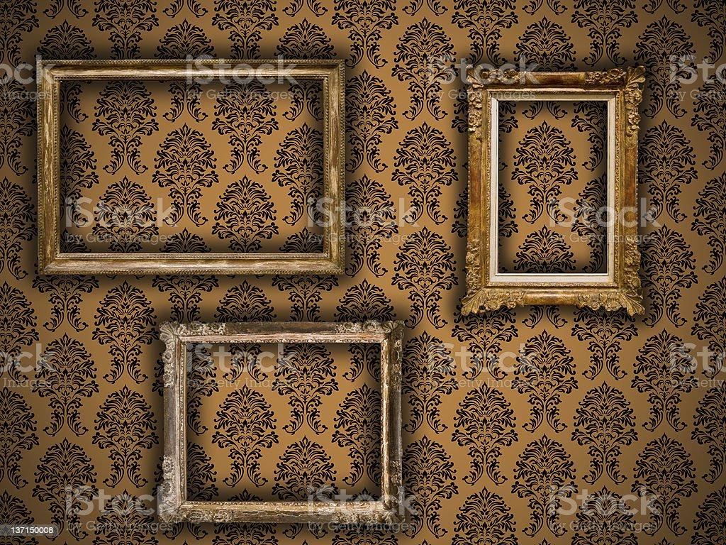 Gilded vintage frames on damask wallpaper background stock photo