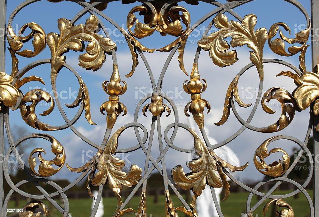 Gilded wrought iron gates stock photo