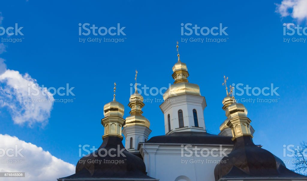 Gilding the dome of the Orthodox cathedral against the blue sky stock photo