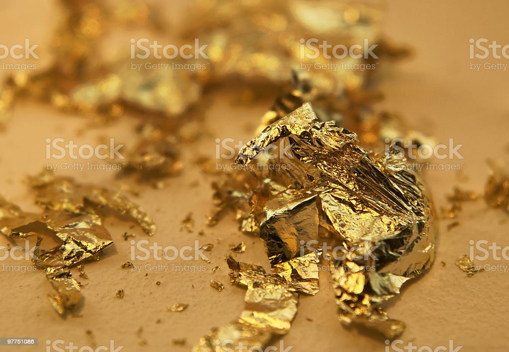 gilding theme with disrupted gold leaves royalty-free stock photo