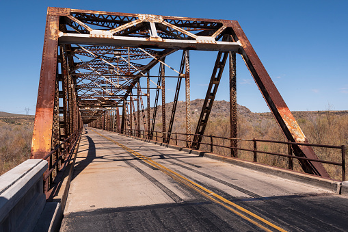 The Gillespie Dam Bridge was built in 1927 on US 80 to span the Gila River in Arlington, Maricopa County, Arizona.  It is part of the Ocean-to-Ocean Highway which was established in 1911.