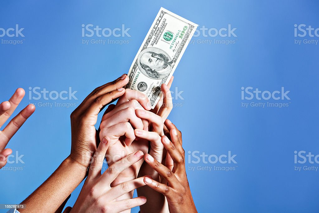 Gimme! Many hands grabbing for US $100 bill against blue royalty-free stock photo