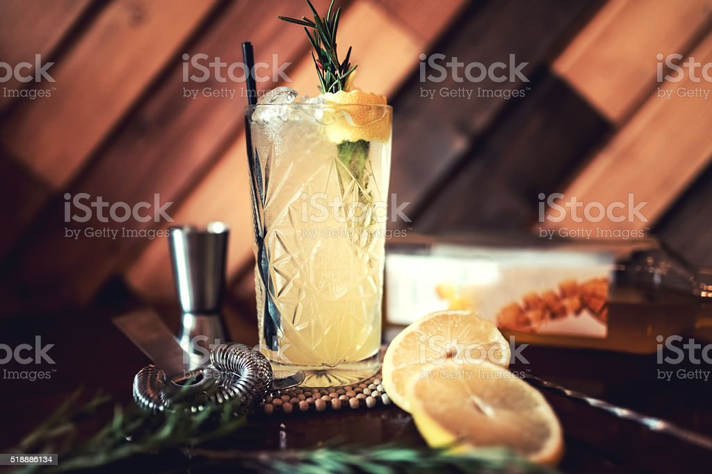 Gin and tonic alcoholic cocktail with lime and ice stock photo