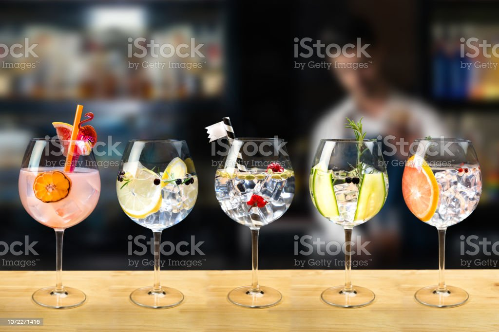 gin and tonic selection garnish Gin and tonic mixed cocktail drinks various selection garnish bartender bar background fashion trendy Alcohol - Drink Stock Photo
