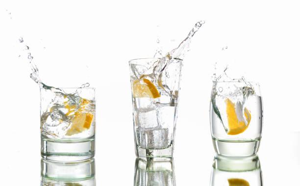 Gin and Tonic Splash Times Three stock photo