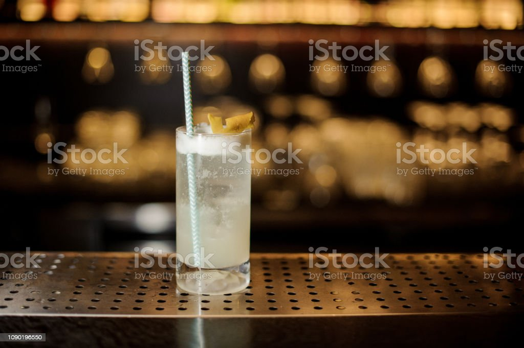 Gin Fizz cocktail with tubule in the decorative glass stock photo