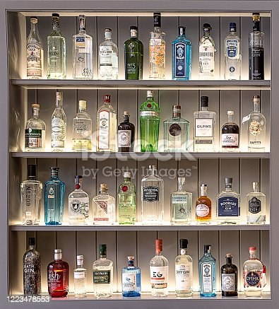 A collection of perfectly positioned gin bottles in four rows